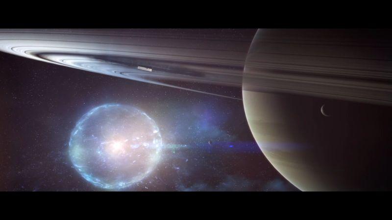 Imagen de un pulso de Luz emanado por the Traveler, con Saturno en primer plano